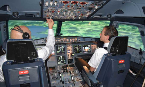 In the cockpit of an A320 flight simulator, an eye-tracking system consisting of cameras and infrared sensors keeps constant track of where the pilot (left) is looking.
